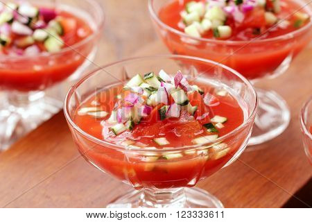 Fresh tomato gazpacho in glass on table