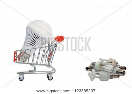 LED light bulbs on a cart and a pile of old bulbs, Isolated on white background.