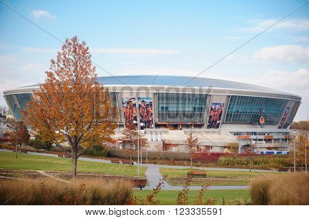 UKRAINE, DONETSK, OCTOBER, 28, 2015: Crowd walk outside of the new Shakhtar Donetsk's soccer stadium.