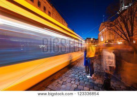 Night Scene of a moving tram in Lviv. Slow shutter speed.