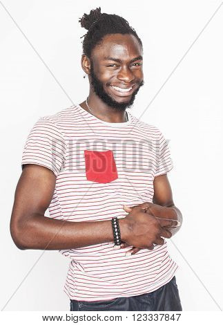 young handsome afro american boy in stylish hipster closers gesturing emotional isolated on white background smiling close up