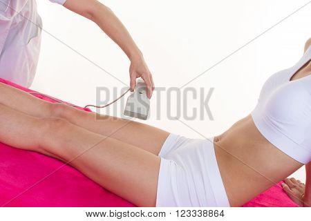 woman at cosmetics salon legs laser epilation