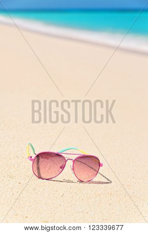 Pink Sunglasses on the beach vertical composition