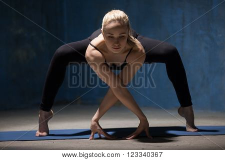 Beautiful Yoga Woman Standing In Forward Bending Squat