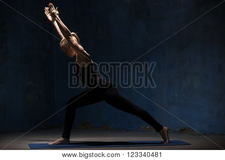 Beautiful Yoga Woman Doing Virabhadrasana 1 Pose