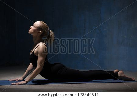 Beautiful Yoga Woman Doing Cobra Pose