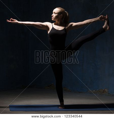 Beautiful Yoga Woman Doing Extended Hand To Big Toe Pose