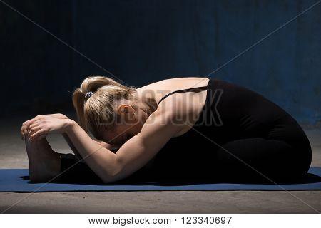 Beautiful Yoga Woman Doing Paschimothanasana Pose
