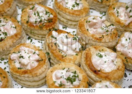 Prawn filled Vol-au-vonts on a buffet table.