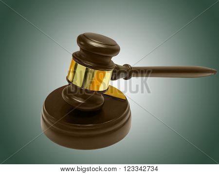 Judge's gavel and soundboard against green background