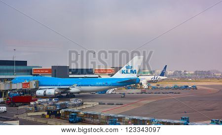 Amsterdam, Netherlands - March 11, 2016: KLM plane being loaded at Schiphol Airport