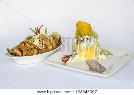 Peruvian Food: Causa Rellena, A smashed popatoes filled with crab meal and Rice with sea food. 2 dishes served as a main meal
