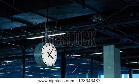 Amsterdam, Netherlands - March 11, 2016: Amsterdam Airport Schiphol in Netherlands. The clock in terminal