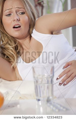 Woman With Stomach Cramps