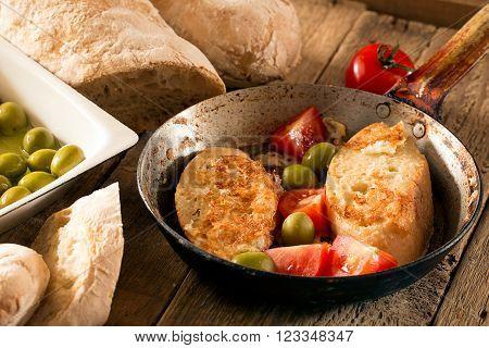 Crusty homemade Italian ciabatta (toasts) on the wooden table