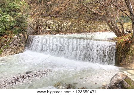 Termopotamos River. Cascade of artificial waterfalls on the mountain Voras by the thermal source.
