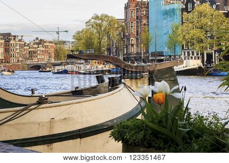 There're accommodation barges moored on the quays of the river Amstel.
