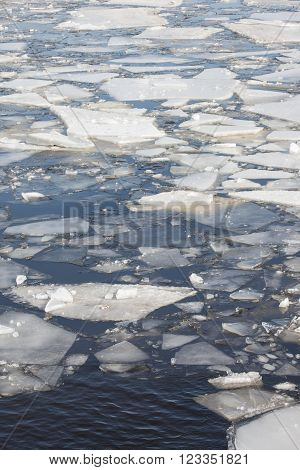 Ice floes background of winter frozen river.