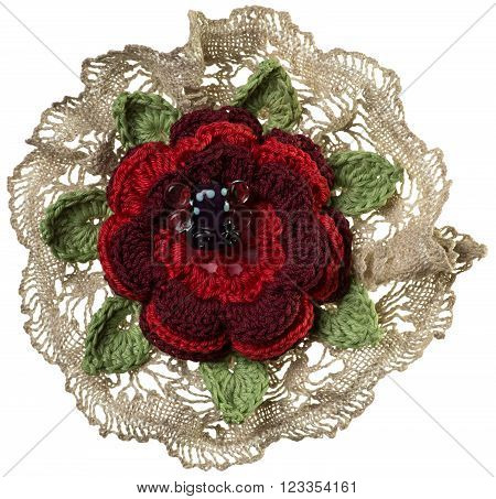 Knitted handmade flower brooch isolated on white background