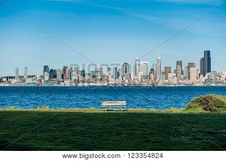 A view of the Seattle skyline with a bench.