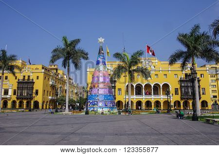 Lima, Peru - January 2, 2015: Plaza Mayor (formerly Plaza de Armas) in Lima Peru with christmas tree in sunny day.