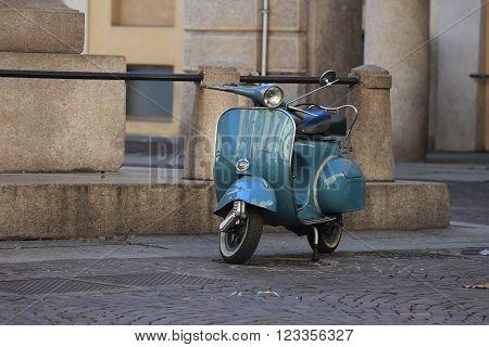 an Old Italian motor-scooter in urban setting