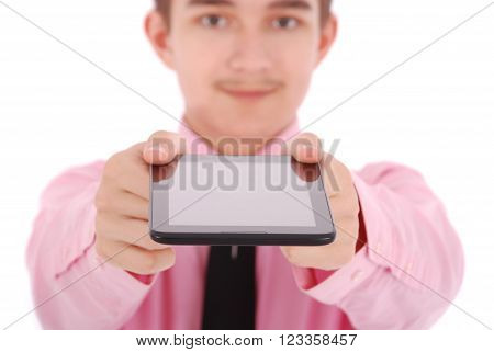 Boy in a pink shirt hold a tablet PC isolated on white. Shallow depth focus on tablet PC ** Note: Shallow depth of field
