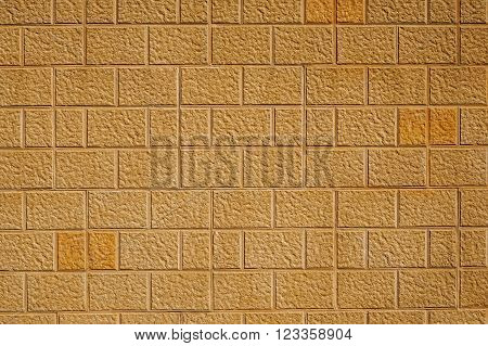 Sand stone effect bricks / blocks wall background texture.