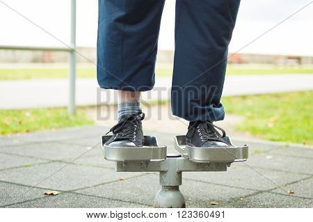 Active Man Exercising On Twister Outdoor.