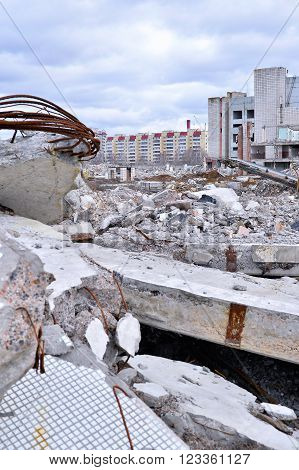 Pieces of Metal and Stone are Crumbling from Demolished Building Floors