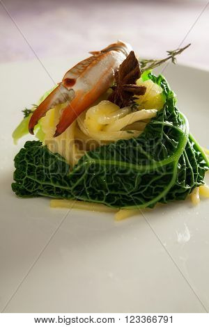 Spaghetti with star anise on a white plate