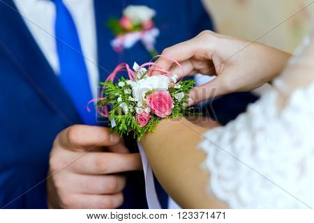 wedding boutonniere. Boutonniere on a hand of the bride