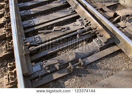 Railway arrows closeup. The symbol of long-distance travel and reliable transportation.
