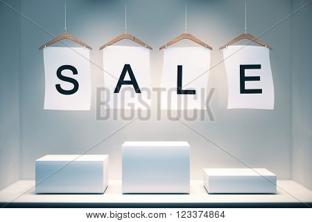 Sale concept with three empty stands in concrete shop interior with sale labels on hangers. Mock up 3D Render