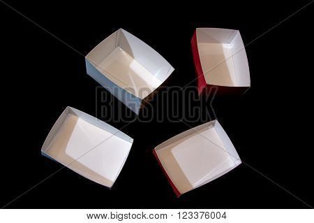 four small colored boxes made of laminated paper