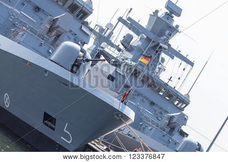 two huge german frigates on a harbor