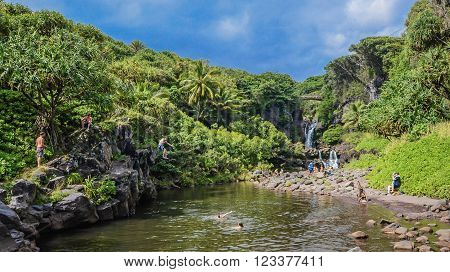 EAST MAUI, HAWAII, USA - NOVEMBER 11, 2014: Tourists and locals enjoy the Pools at Ohe'o Gulch in Haleakala National Park