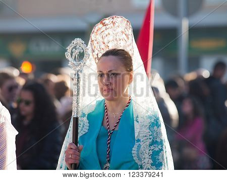 Algeciras Spain - 20 March 2016 Female participant at Palm Sunday Procession in. The woman carries the traditional head coverage called mantilla