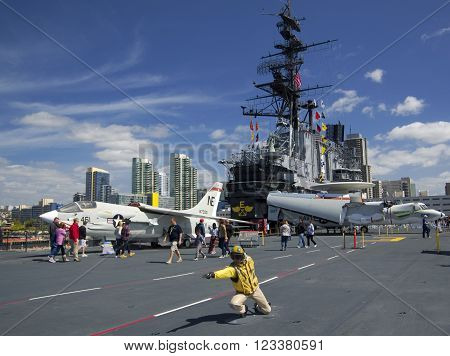 SAN DIEGO California USA - March 13 2016: aircraft carrier USS Midway (CV-41) flying deck with aircrafts museum in San Diego harbour USA