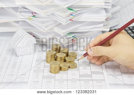 Man Is Auditing Account With Step Gold Coins
