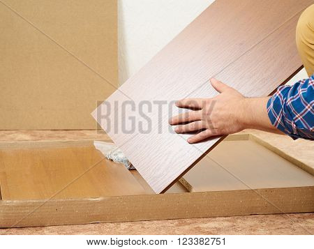 Man Opens Box With Furniture