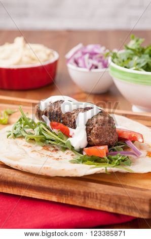 roasted lamb kofte with cool yogurt tzatziki and hummus