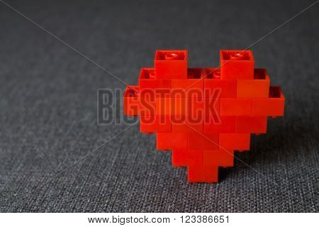 Make love. Heart. Red Bricks Elements of  Constructor at Textile Background.
