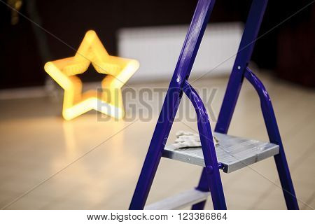 Step ladder closeup, decorating the banquet hall of the event.