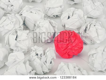 Set of crumpled white paper with a red ball of crumpled paper on white background, top view