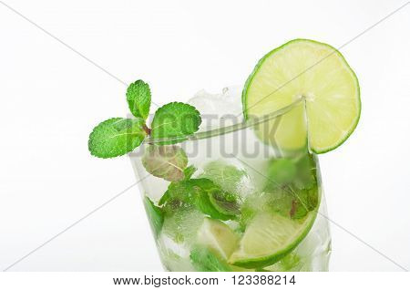 Closeup mojito cocktail with lime and mint in tumbler glass on white background