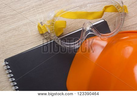 Industrial orange helmet for compliance with safety and the safety notes
