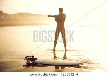 A surfer warming up before going catch some waves