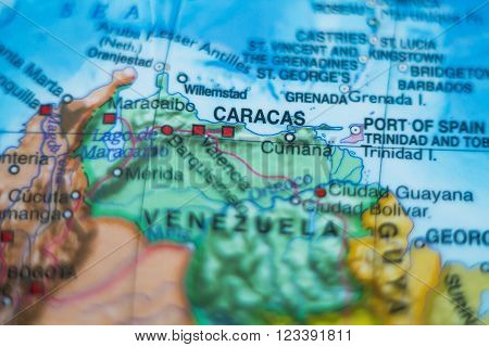 Photo of a map of Venezuela and the capital Caracas . ** Note: Shallow depth of field