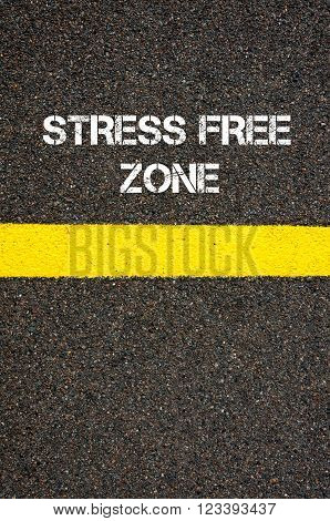 Road marking yellow paint dividing line with words STRESS FREE ZONE, concept image